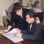 Dans son bureau de l'Avenue Carnot, il feuillette un récent manuscrit pour son épouse. (circa 1956)