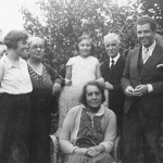 Near his mother (seated) sharing the family happiness with his mother-in-law (Hilda Jolivet's mother), his father, his sister Hélène and Madeleine, his niece (1933).